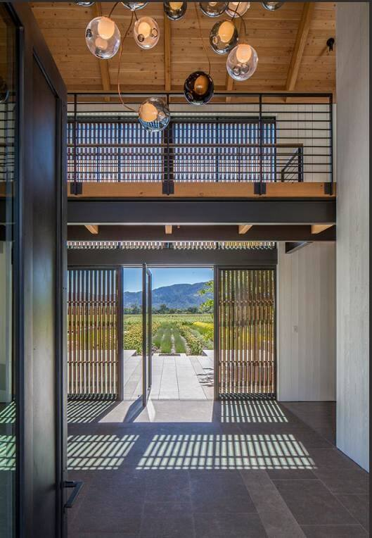 Architect Melanie Turner included this catwalk in her design to create a separation between the working and living spaces in a Napa Valley home.  (Art Gray)