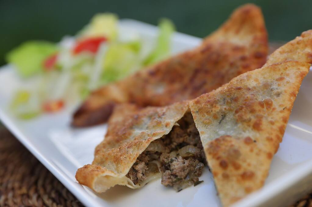 Choose from ground beef, onion and parsley or whole lentil, onion and green pepper sambusas as an appetizer at Abyssinia. (Christopher Chung/The Press Democrat)