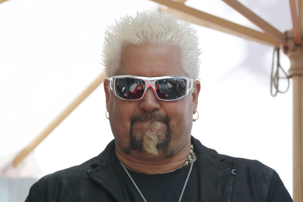 Guy Fieri attends a ceremony honoring him with a star at the Hollywood Walk of Fame on Wednesday, May 22, 2019, in Los Angeles. (Photo by Willy Sanjuan/Invision/AP)