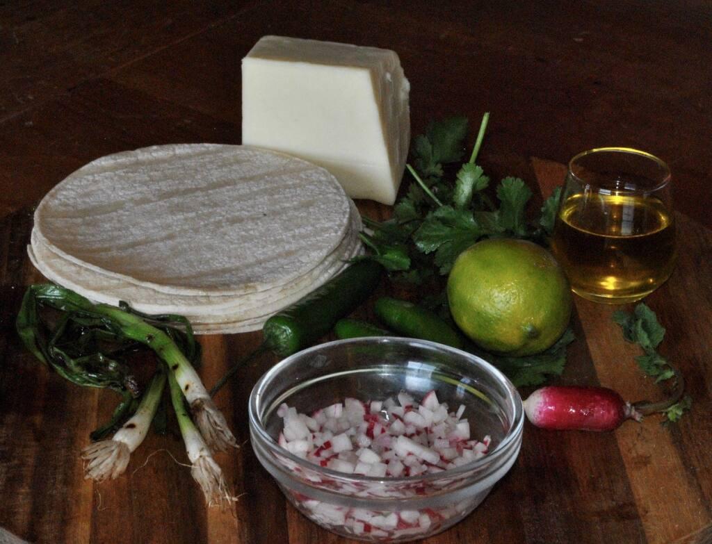 Make a Radish Salsa from radishes,  serrano peppers, garlic, lime, cilantro and olive oil.  (Gina Jordan)