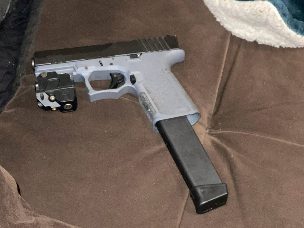 A gun with an extended magazine detectives discovered during a search of the Santa Rosa apartment. (Santa Rosa Police Department)