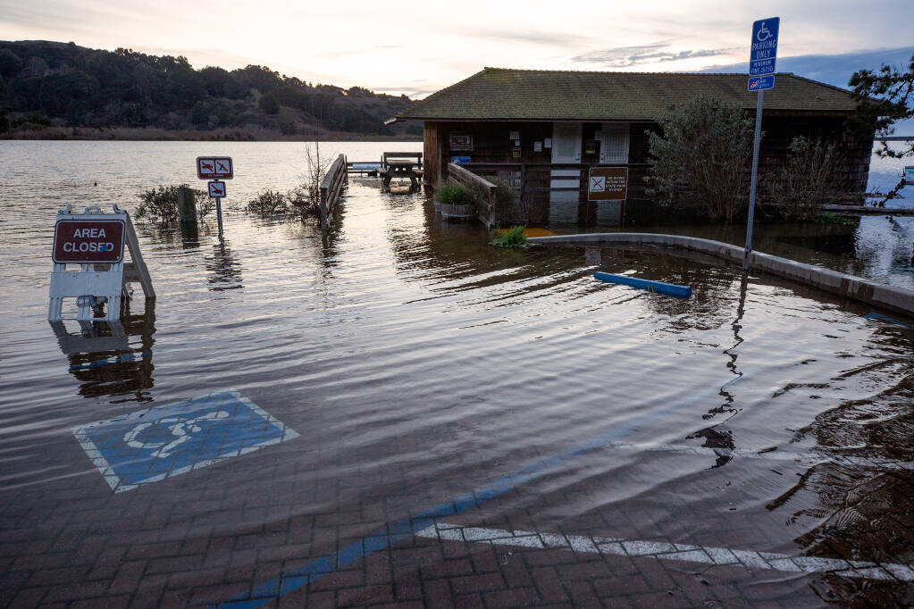 Water from the Russian River begins to innundate the Jenner visitor center and its parking lot in Jenner, California, on Thursday, Jan. 7, 2021. (Alvin A.H. Jornada / The Press Democrat)