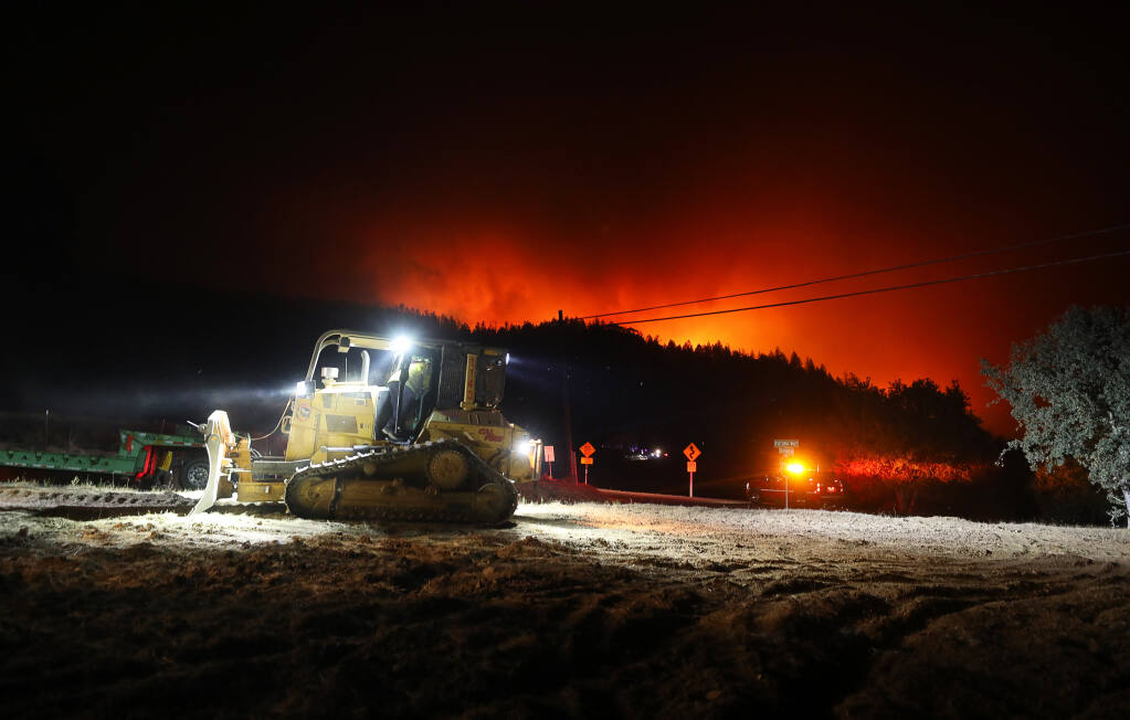Bulldozer crews prepare to cut fire breaks as the Shady fire advances towards Los Alamos Road in Santa Rosa on Sunday, September 27, 2020.  (Christopher Chung/ The Press Democrat)