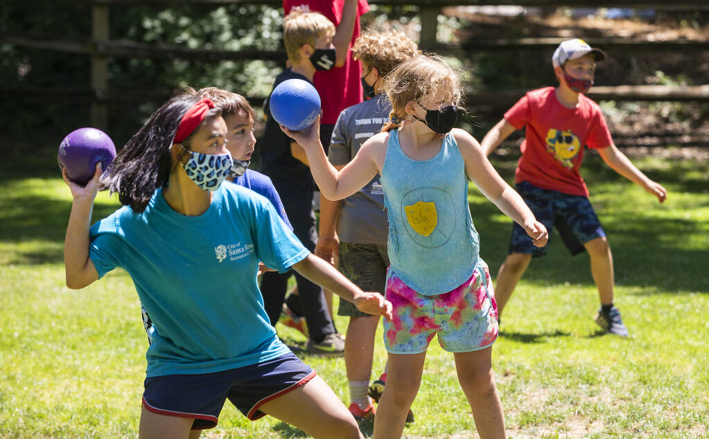 Camp Wa-Tam campers play dodgeball in Howarth Park in Santa Rosa on Thursday, July 15, 2021. (Photo by John Burgess/The Press Democrat)