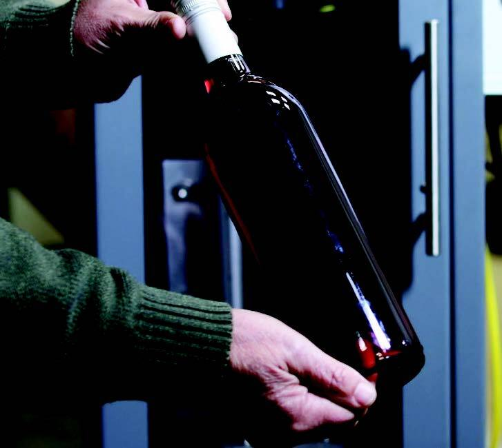 This is what a wine bottle is supposed to look like after it comes out of the Lola 200 label stripper machine, which first started selling in late August. Bottlers and wineries commonly hire temporary workers to remove labels by hand, using a tub soak and razor blades. (courtesy of Alpine Engineering Solutions)