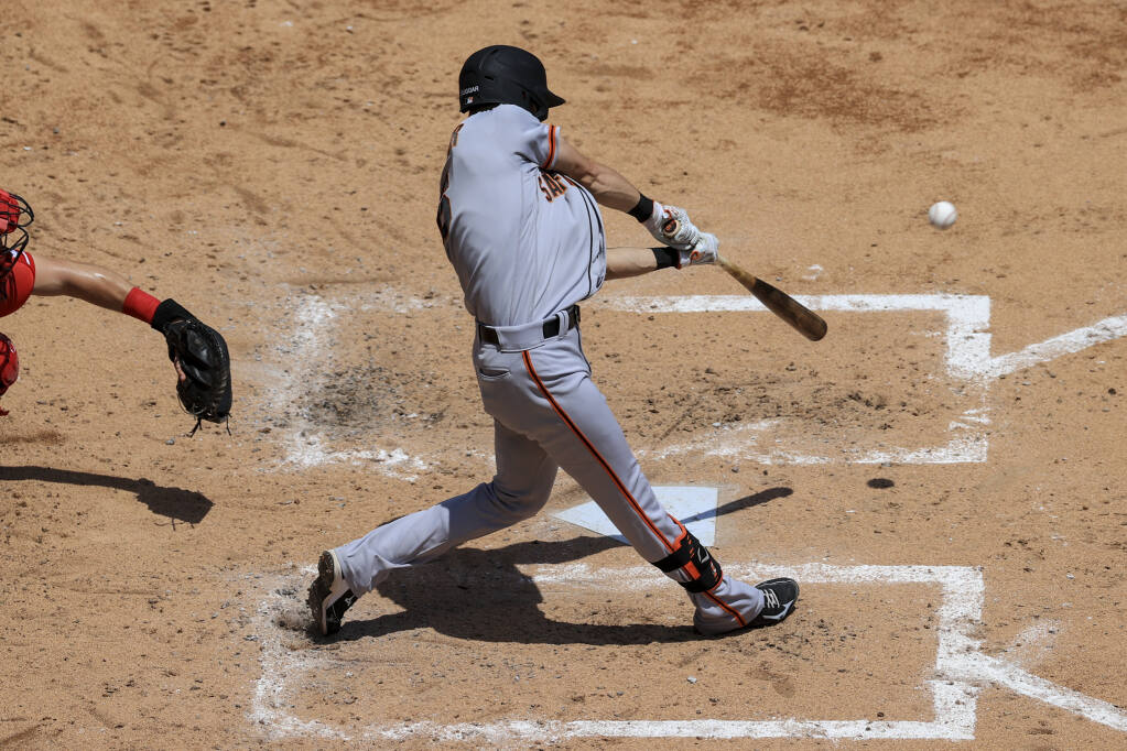 The San Francisco Giants' Steven Duggar hits a grand slam during the third inning against the Cincinnati Reds in Cincinnati on Thursday, May 20, 2021. (Aaron Doster / ASSOCIATED PRESS)