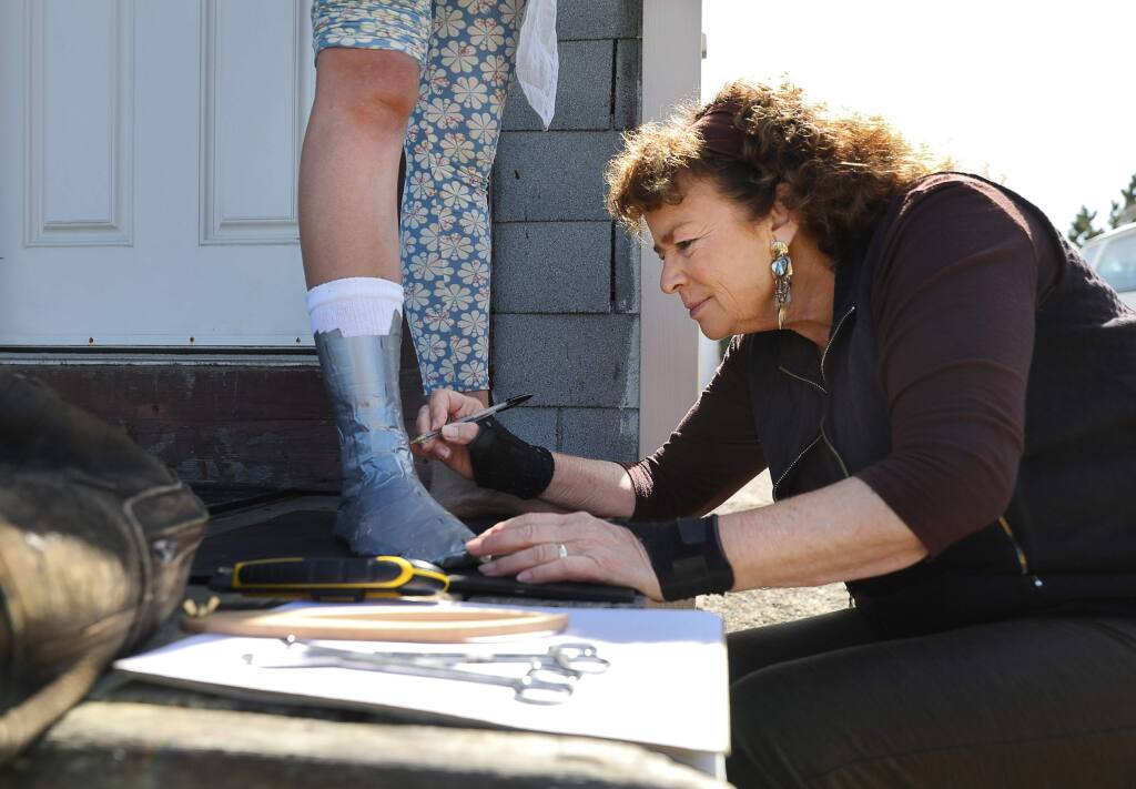 Angel Fiorito-Leddy works on making a cast for a pair of custom boots for Alana Stuart at her Windwalkers studio in Bodega Bay on Thursday, August 22, 2019. Fiorito-Leddy sells her WindWalkers slippers and boots at the Artisans' Co-op Gallery in Bodega.(Christopher Chung/ The Press Democrat)