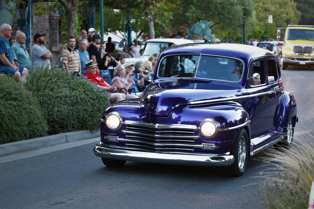 More than 200 cars cruise Cloverdale Boulevard during the 26th Annual Cloverdale Car and Motorcycle Show in Cloverdale, California on Friday, Sept. 6, 2019. (WILL BUCQUOY/ FOR THE PD)