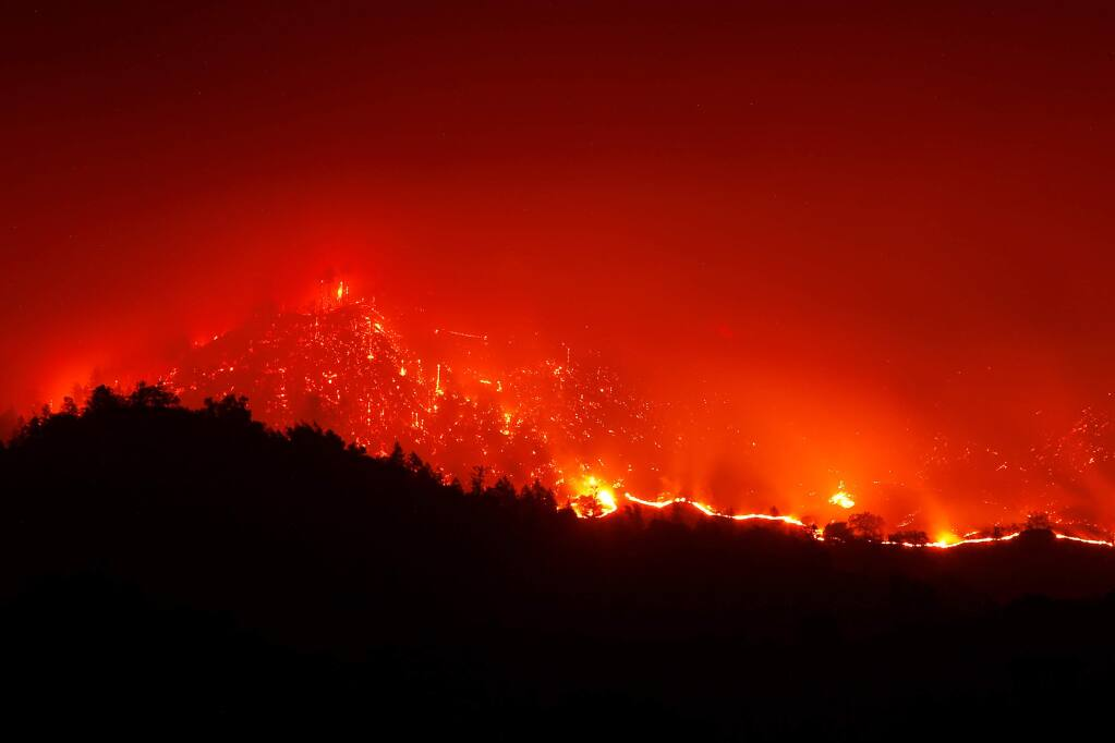 The Kincade Fire burns in the hills above Geyserville, California, on Friday, October 25, 2019. (Alvin Jornada / The Press Democrat)