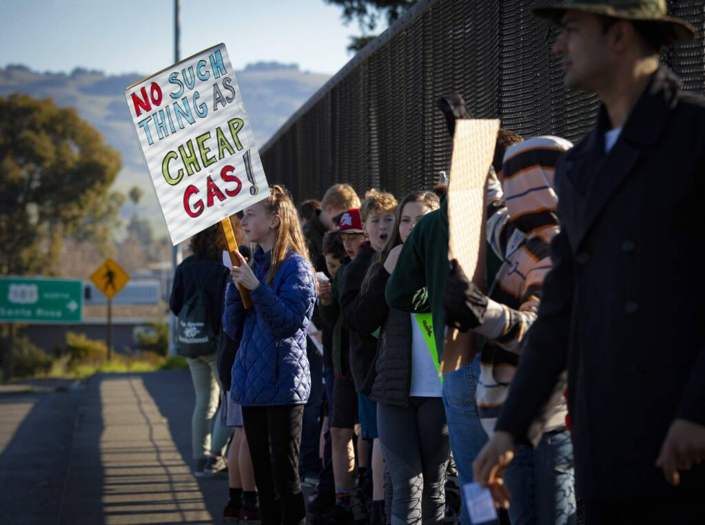 Petaluma, CA, USA._Friday, March 15, 2019. Students from Petaluma schools participated in a rally and protest over climate change and the current administration's environmental policies. The 'climate strikers' walked out of school and marched on East Washington to the freeway overpass to bring attention to their cause.(CRISSY PASCUAL/ARGUS-COURIER STAFF)
