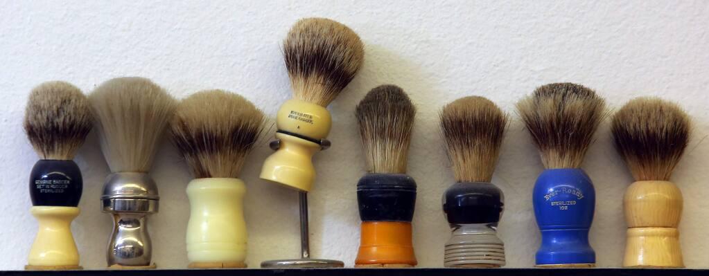 Barber Shop in Santa Rosa has a collection of shaving brushes. (JOHN BURGESS / The Press Democrat)