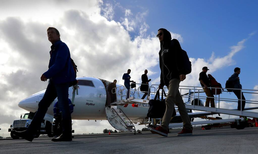 Passengers arrive on the first American Airlines flight from Phoenix at the Charles M. Schulz-Sonoma County Airport on Thursday afternoon, February 16, 2017. (John Burgess/The Press Democrat)