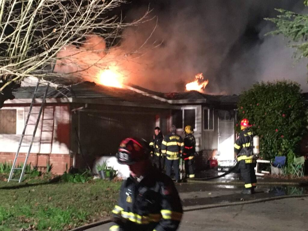 A west Santa Rosa home is engulfed in flames Wednesday, Feb. 20, 2019. Firefighters said they found a body amid the wreckage. (Matt Gustafson)