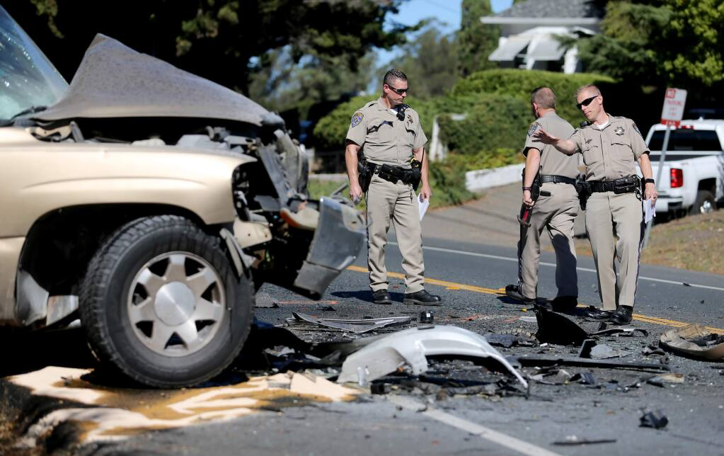 CHP officers investigate the scene of a double fatality on Bodega Avenue on Sunday, Oct. 7, 2018, in Petaluma, California. (BETH SCHLANKER/ PD)