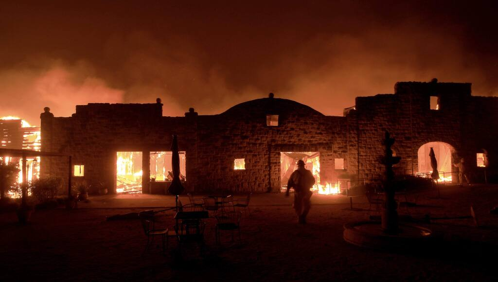Soda Rock Winery in the Alexander Valley is a victim of the Kincade fire Sunday morning as critically strong winds pushed the fire over Highway 128. (KENT PORTER/ PD)
