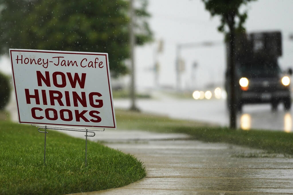 A hiring sign is shown in Downers Grove, Ill., Thursday, June 24, 2021. The number of Americans collecting unemployment benefits slid last week, another sign that the job market continues to recover rapidly from the coronavirus recession.Jobless claims dropped by 24,000 to 400,000 last week, the Labor Department reported Thursday, July 29, 2021. (AP Photo/Nam Y. Huh, File)