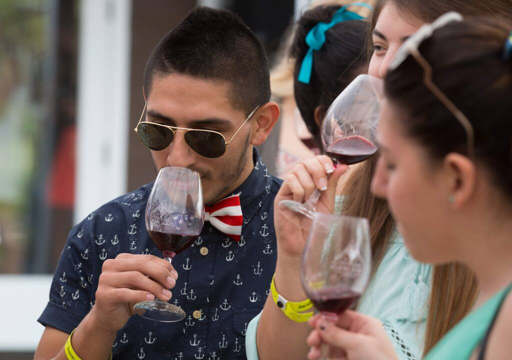 Mauricio Fernandez samples a glass of wine at the Truett-Hurst Winery in Healdsburg during Wine Road Northern Sonoma County's 37th Annual Barrel Tasting in 2015. (PD FILE)