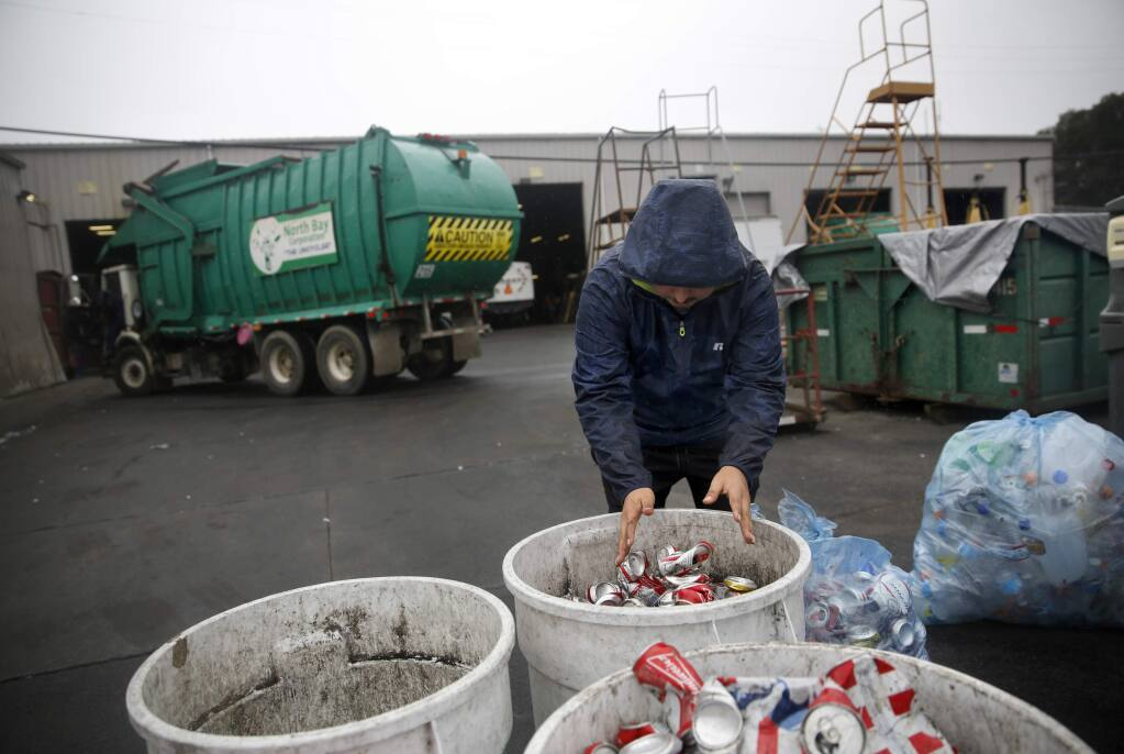 Julio Luna drops off bags of cans and bottles from a recent party at Redwood Empire Disposal on Monday, October 24, 2016 in Santa Rosa, California . (BETH SCHLANKER/ The Press Democrat)