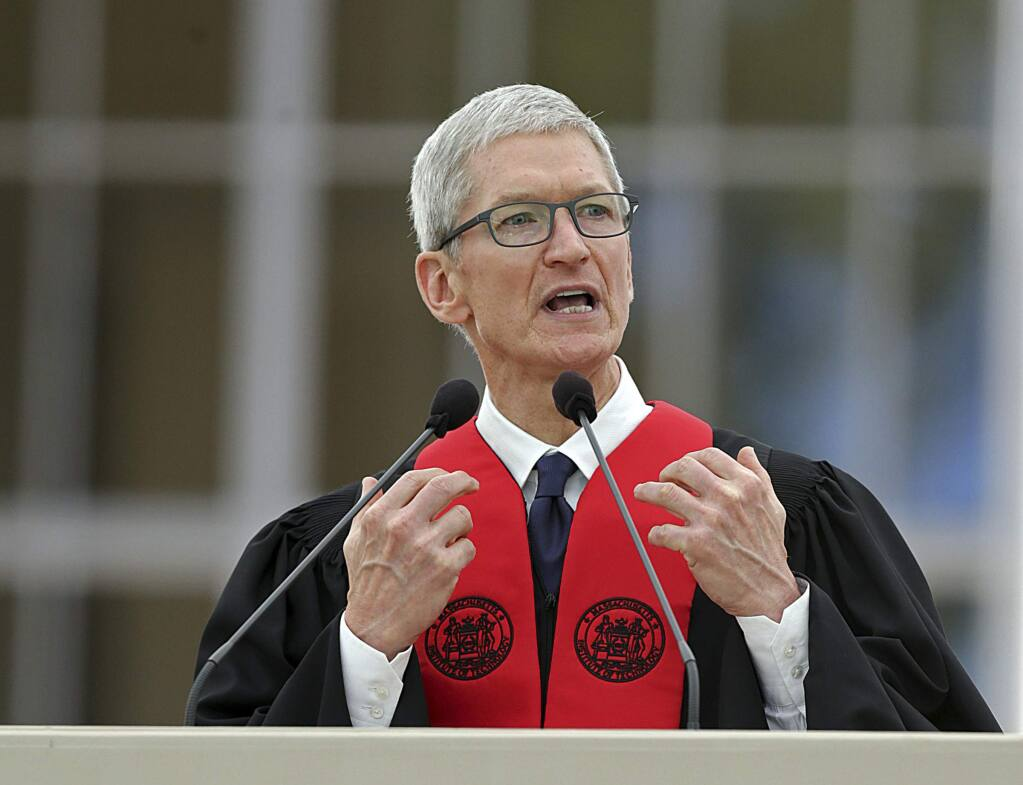 Apple CEO Tim Cook speaks during a commencement address at the Massachusetts Institute of Technology, Friday, June 9, 2017, in Cambridge, Mass. Cook told MIT graduates and their families that technology without basic human values is worthless. (John Wilcox/The Boston Herald via AP)