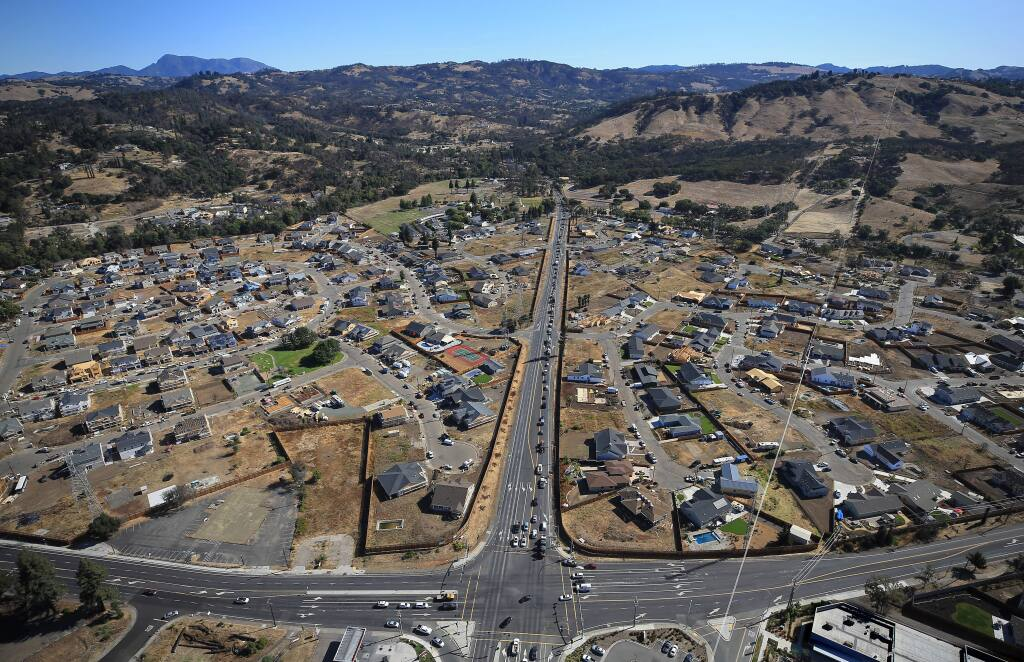 Old Redwood Highway and Mark West Springs Road splits Larkfield in the Tubbs fire rebuild zone, Friday, Sept. 20, 2019. (Kent Porter / The Press Democrat)