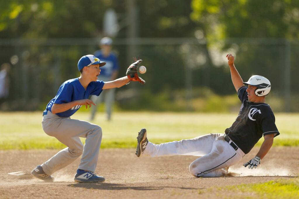 Credo's Claude Pepe (17), right, slides safely into second base before Technology's Cayden Thompson (27) can tag him, during a varsity baseball game between Technology and Credo high schools at Golis Park in Rohnert Park, California, on Tuesday, April 30, 2019. (Alvin Jornada / The Press Democrat)