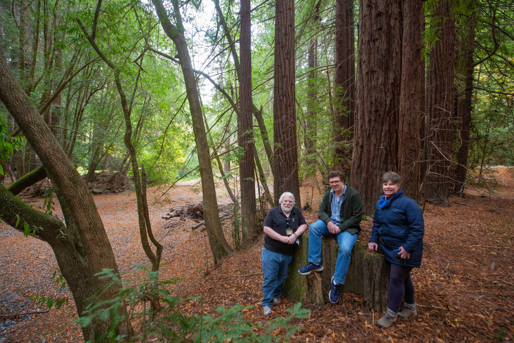 Former owners Michael Torr, left, his son, Kyle, and sister Michele McDonell pose for a portrait beside Dutch Bill Creek at the 515-acre property that will become Sonoma County's newest park in Monte Rio on Wednesday, Nov. 11, 2020. (Alvin A.H. Jornada / The Press Democrat)