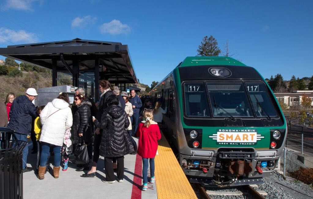 Passengers disembark the SMART train at the newly opened Larkspur SMART Train Station after taking the inaugural ride to Larkspur, Calif., on Saturday, December 14, 2019. (Photo by Darryl Bush / For The Press Democrat)