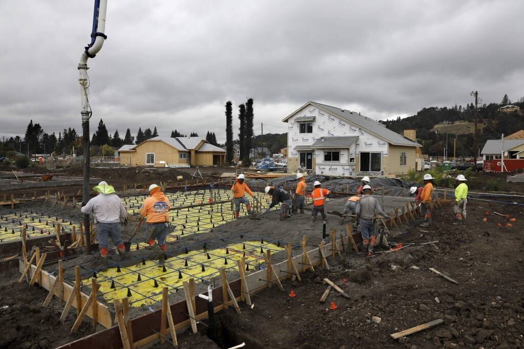 Employees of CVC Concrete pour a foundation for a home being built by Stonefield Development in Mark West Estates in Larkfield-Wikiup on Thursday, October 4, 2018. (Beth Schlanker/ The Press Democrat)