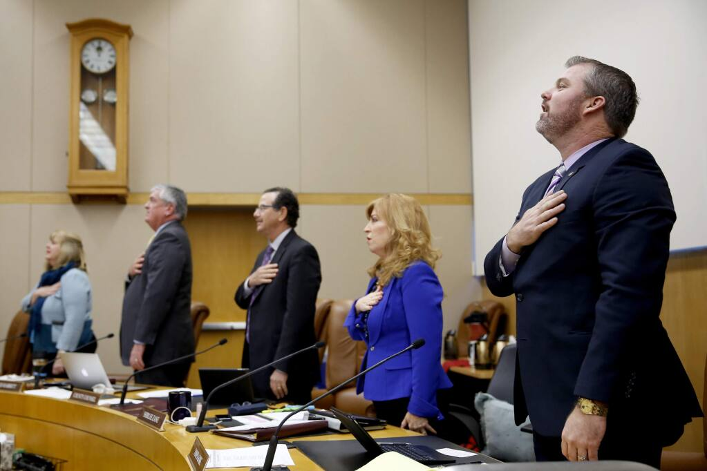 4th District Supervisor James Gore says the Pledge of Allegiance during the Sonoma County Board of Supervisors meeting in Santa Rosa, California on Tuesday, January 6, 2015. (BETH SCHLANKER/ The Press Democrat)