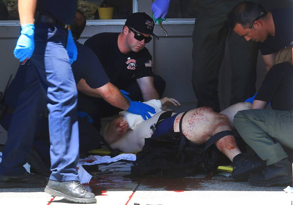 Windsor firefighters and Bell's paramedics tend to Loomis shooting victim in front of Chase Bank in Windsor on Tuesday July 12, 2016. (KENT PORTER/ PD)