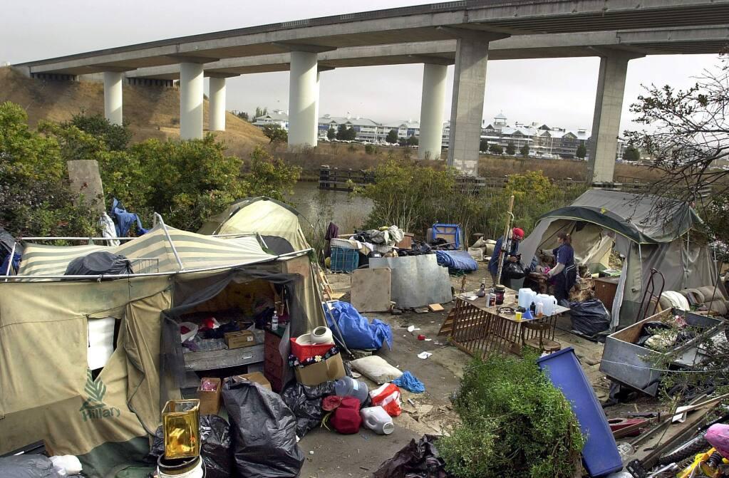 A homeless camp along the Petaluma River in 2001. (PD FILE)