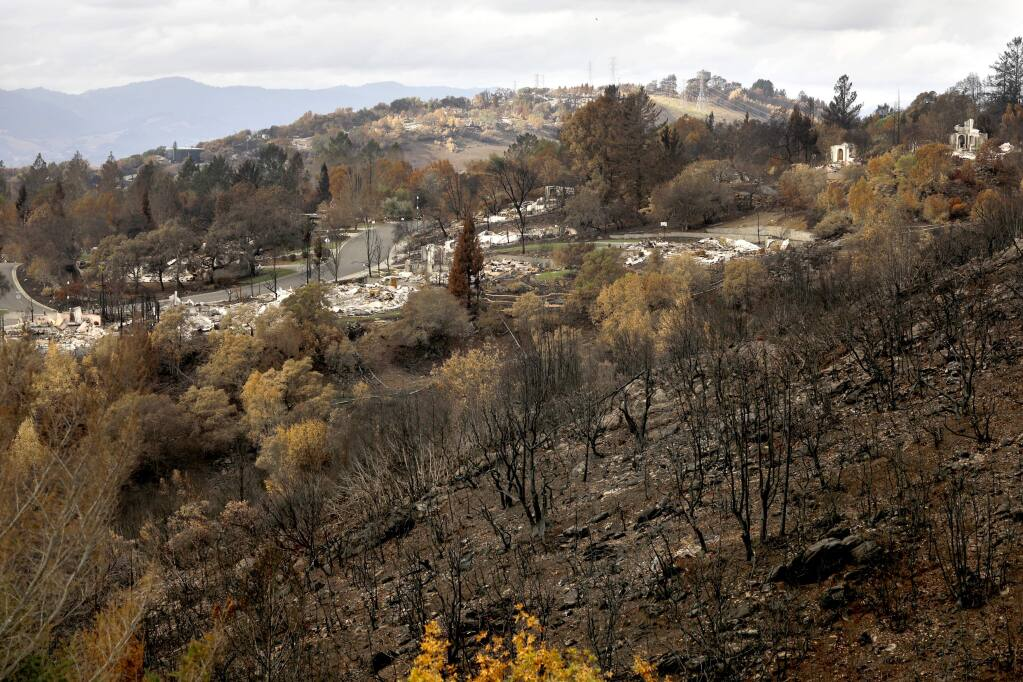 Burned vegetation covers the hillsides around the remnants of homes destroyed in the Tubbs fire in the Fountaingrove area of Santa Rosa. Photo taken on Sunday, November 12, 2017. (BETH SCHLANKER/ The Press Democrat)