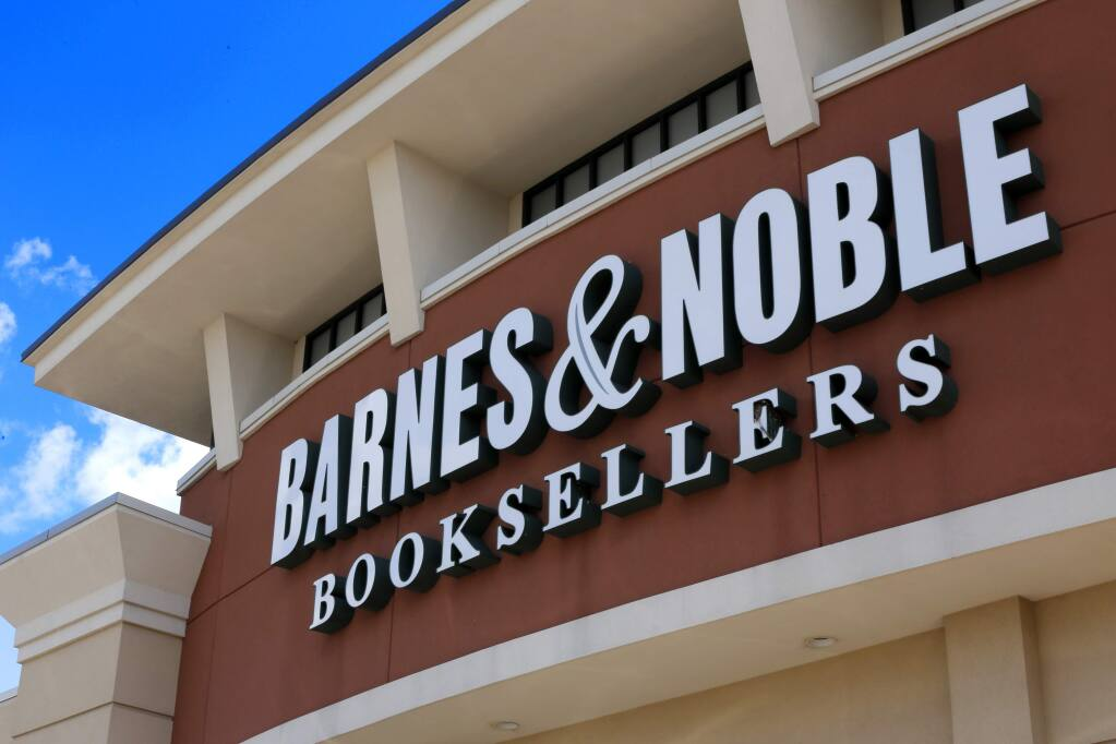 """FILE - This Monday, Aug. 31, 2017, file photo shows a Barnes & Noble Booksellers store in Pittsburgh. Barnes & Noble is withdrawing a planned line of famous literature reissued with multicultural cover images that has drawn widespread criticism on social media. 'Diverse Editions,"""" a joint project between Barnes & Noble and Penguin Random House, featured 12 texts, including Lewis Carroll's """"Alice's Adventures in Wonderland."""" The words are the same, but on the covers, major characters are depicted with dark-skinned illustrations. (AP Photo/Gene J. Puskar, File)"""