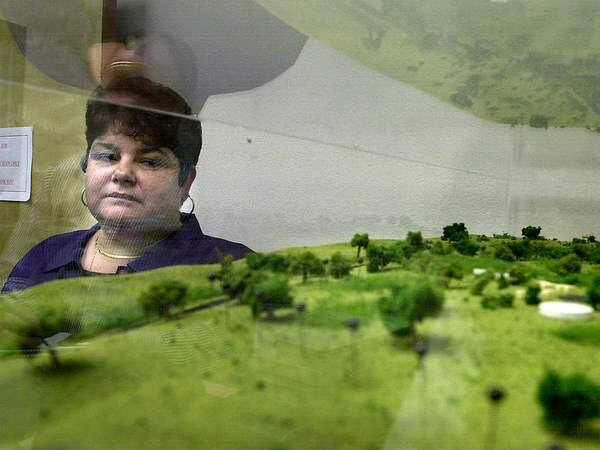 Margie Mejia, chairperson for Lytton Rancheria, stands near the model that shows how the 50 acres of land on Windsor River Road would be developed for Lytton Band of Pomo Indians. (PRESS DEMOCRAT FILE PHOTO)