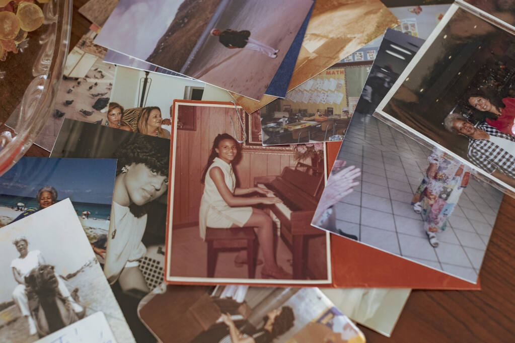 A photograph of Alina Lopez Miyares at the home of her mother, Alina Miyares, in Miami, March 15, 2021. It was a romance steeped in international intrigue, and it landed Lopez Miyares in a Cuban prison. How much did she know about the web that entangled her? (Saul Martinez/The New York Times)