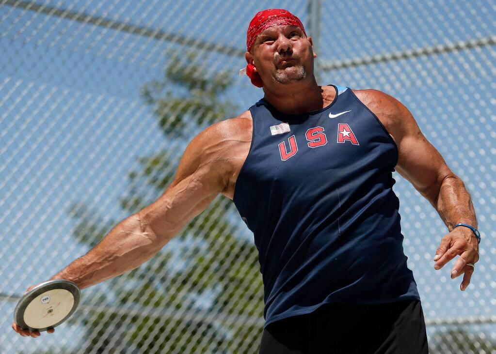 Cameron Bolles, 53, two-time discus world champion, practices at Santa Rosa High School, in Santa Rosa on Tuesday, June 6, 2017. (Alvin Jornada / The Press Democrat)