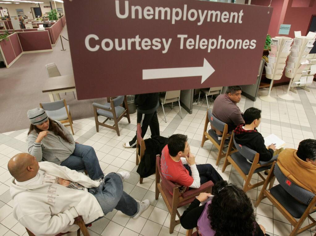 People wait their turn to talk with unemployment benefits staff at an Employment Development Department office in San Jose, Calif., Friday, Jan. 23, 2009.(AP Photo/Marcio Jose Sanchez)