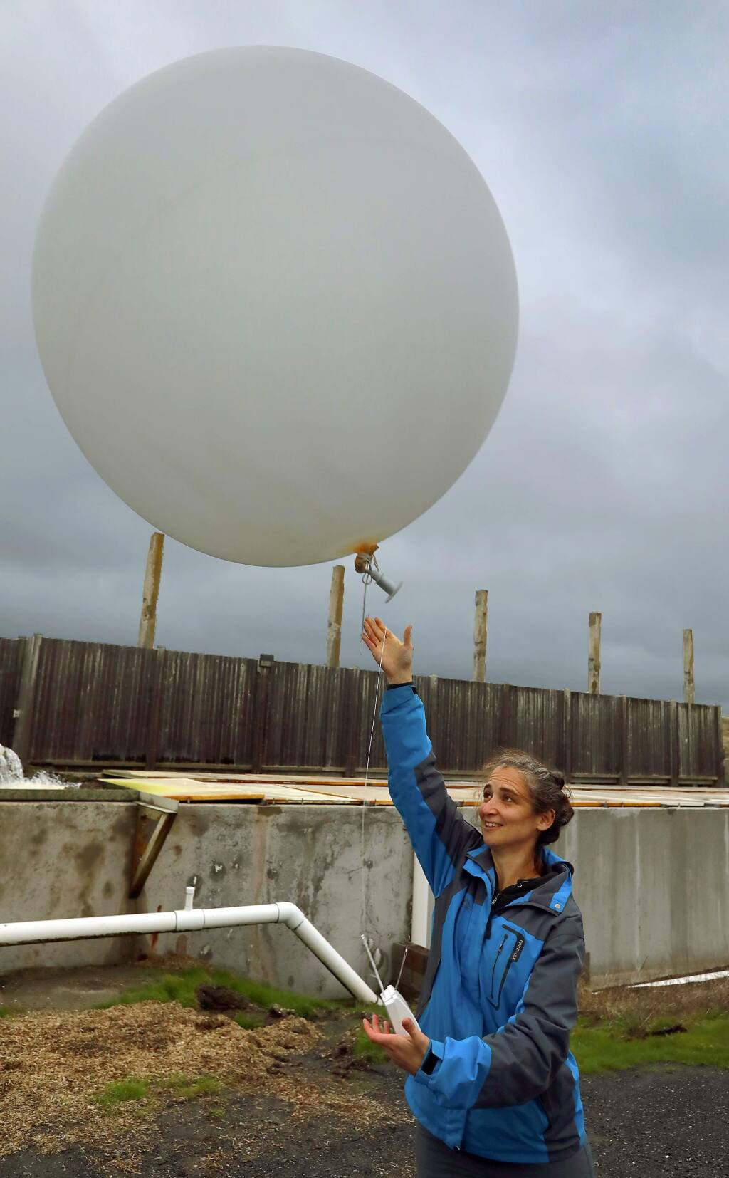 Anna Wilson, with the Scripps Institution of Oceanography, releases a weather balloon to study atmospheric rivers in the region. The balloon was released Sunday at 4 p.m. at the Bodega Marine Labs at the same time as another was released near Lake Mendocino in Ukiah. (John Burgess/The Press Democrat)