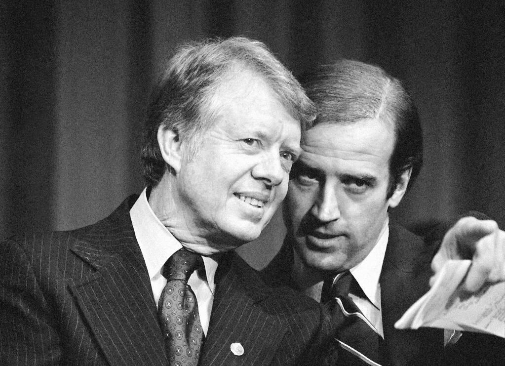 President Jimmy Carter listens to Sen. Joe Biden as they wait to speak at a 1978 fundraising reception in Wilmington, Delaware. (BARRT THUMMA / Associated Press)