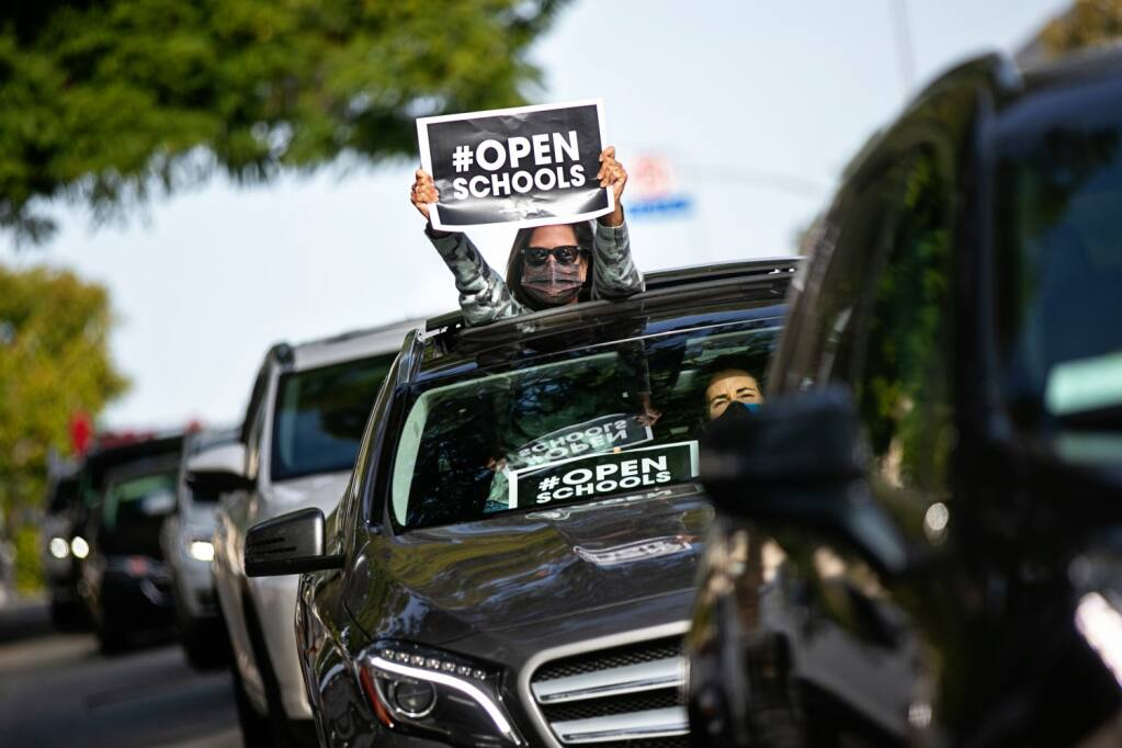 Los Angeles parents participate in a Feb. 15 car caravan in support of reopening schools.  (JASON ARMOND / Los Angeles Times)