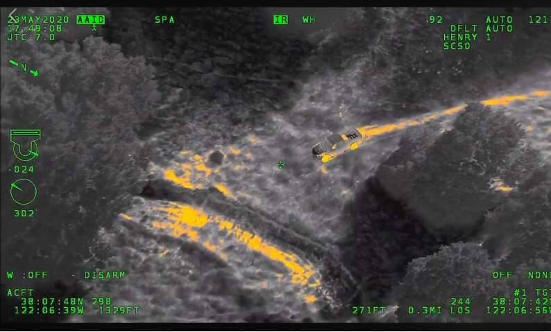 Image from videotape of a Henry-1 helicopter chase of a felony theft suspect. Image is in night-vision mode. (SCSO)