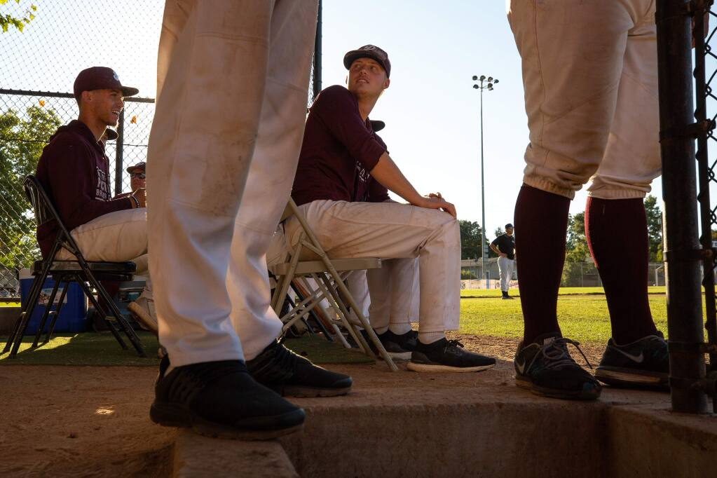 Prune Packers pitchers Trey Garlett, right, and Shamus Lyons watch the game from the dugout area during a game against the San Francisco Seals, at Healdsburg Recreation Park in Healdsburg on Wednesday, July 10, 2019. (Alvin Jornada / The Press Democrat)