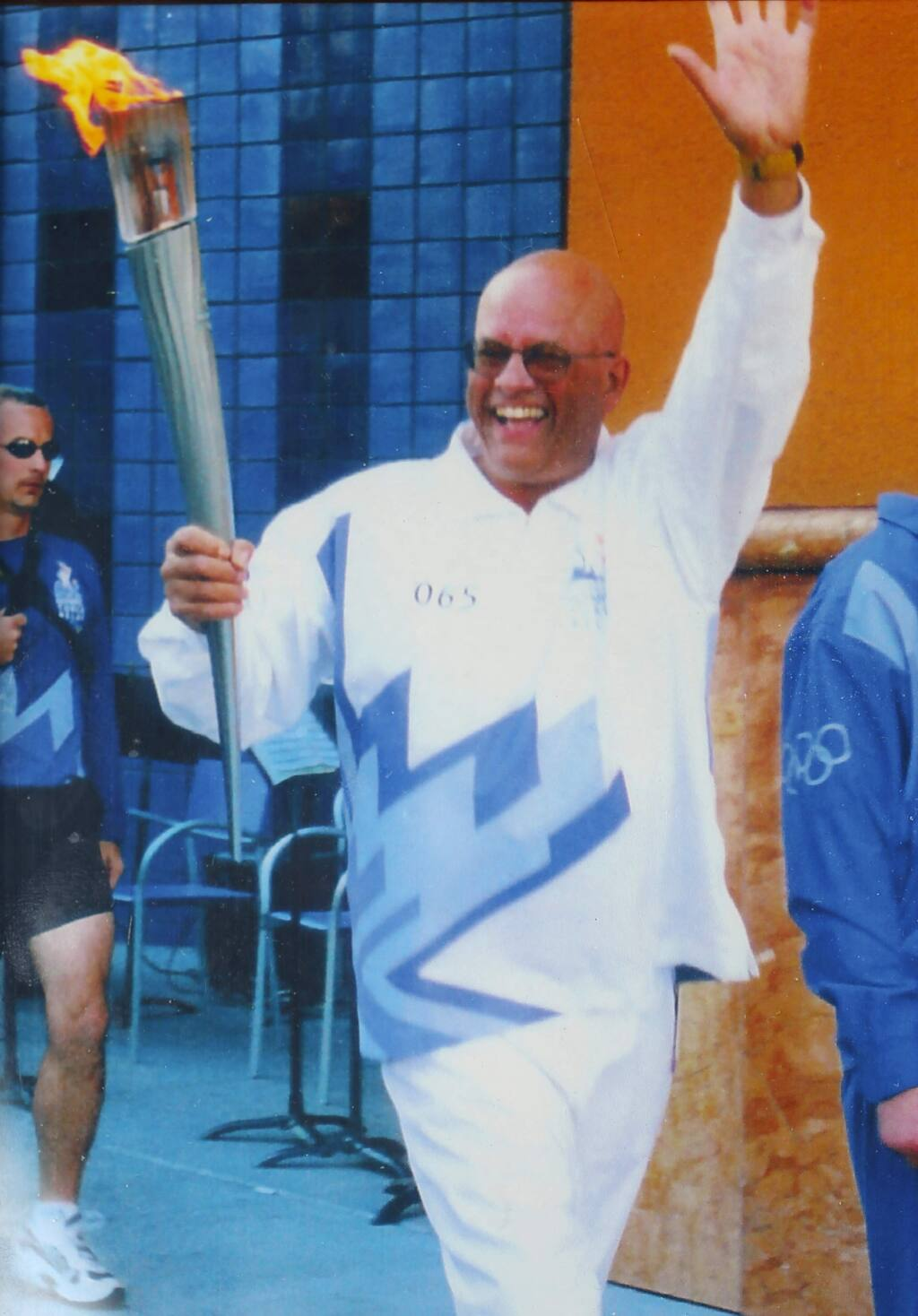 Tom Francois carrying the Olympic torch in 2002.(Photo courtesy Tom Francois)