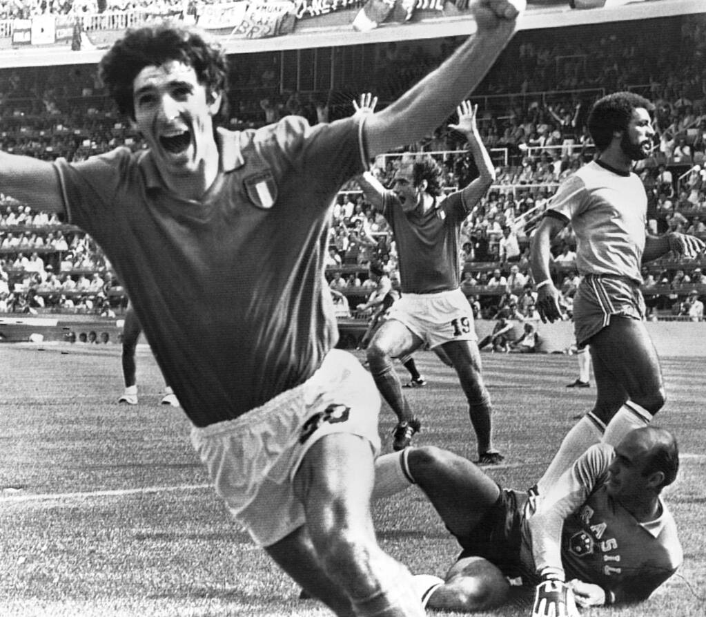 FILE - In this July 5, 1982 file photo, Italy's Paolo Rossi, left, celebrates, after scoring the second goal for his team during their World Cup second round soccer match against Brazil, in Barcelona, Spain. Rossi died of Cancer, Dec. 10, 2020. He was 64. (AP Photo/File)