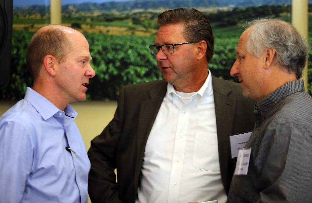 """Director of the California Department of Fish and Wildlife Charlton """"Chuck"""" Bonham, left, talks with Grant Davis, center, and Jay Jasperse from the Sonoma County Water Agency after a press conference at Kendall=Jackson Wine Estates in Santa Rosa on friday.(JOHN BURGESS / The Press Democrat)"""