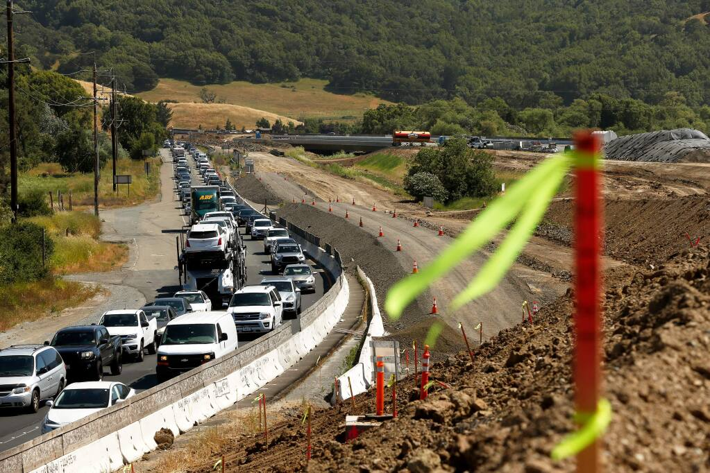Motorists drive northbound in afternoon traffic on Highway 101, beside the road construction zone south of Petaluma, California, on Wednesday, May 30, 2018. (ALVIN JORNADA/ PD)