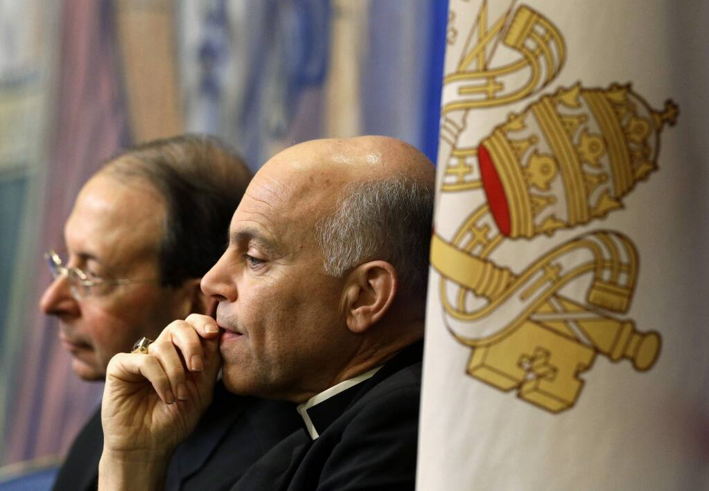 FILE - In this Nov. 12, 2012 file photo, Archbishop Salvatore Cordileone, of San Francisco, center, and Archbishop William Lori, of Baltimore, listen to a speaker during the United States Conference of Catholic Bishops' annual fall meeting in Baltimore. Local Catholics have gone public with their complaints about the San Francisco archbishop. On Thursday, April 16, 2015, an advertisement in the San Francisco Chronicle shows more than 100 Catholics have signed a full-page newspaper advertisement asking Pope Francis to remove Cordileone. (AP Photo/Patrick Semansky, File)