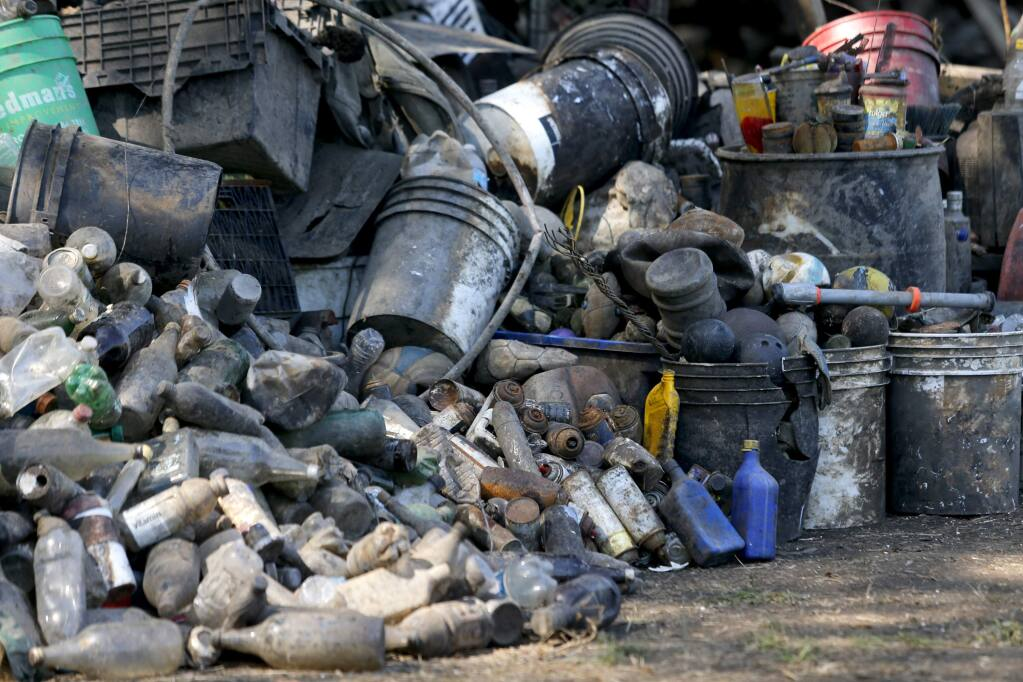 Piles of garbage from the Laguna de Santa Rosa sit on display during the 'Great Laguna Garbage Patch' event in Santa Rosa, on Thursday, September 17, 2015. (BETH SCHLANKER/ The Press Democrat)