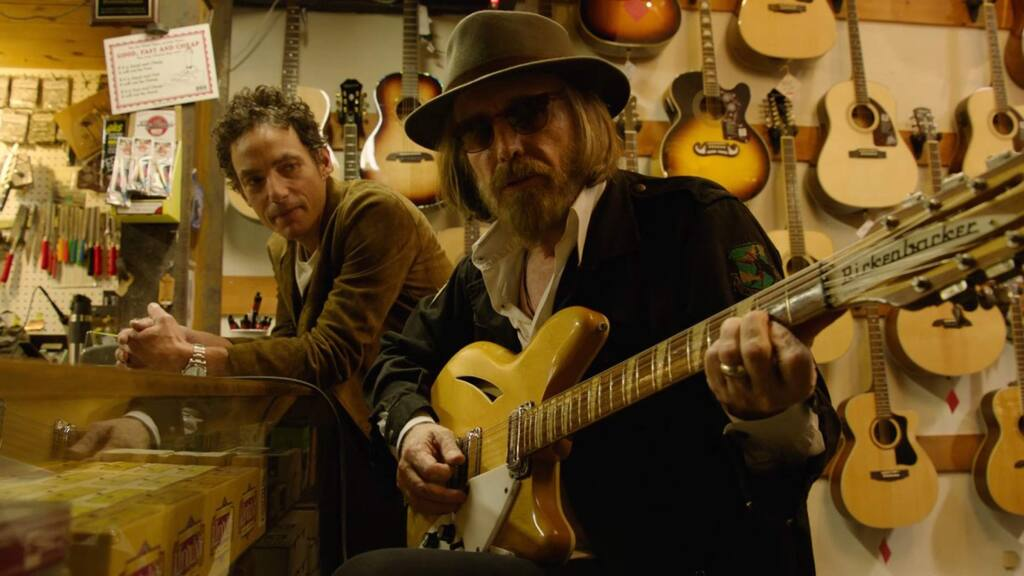 Jakob Dylan and the late Tom Petty in 'Echo in the Canyon.' The documentary revisits the 1960s music scene in Los Angeles's Laurel Canyon neighborhood, where a singular collection of musicians from all over - drawn by a combination of hilly seclusion and proximity to Hollywood recording studios - fostered an era-defining vibe of collaboration, freedom and poetic inspiration. (Greenwich Entertainment)