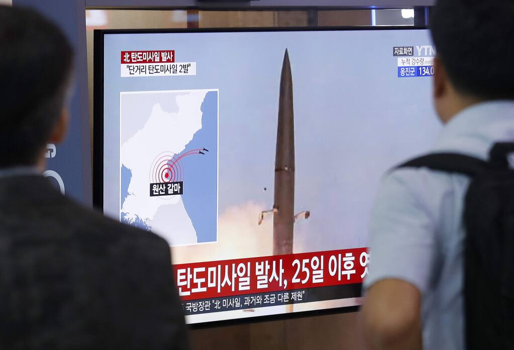 People watch a TV showing a file image of North Korea's missile launch during a news program at the Seoul Railway Station in Seoul, South Korea, Wednesday, July 31, 2019. North Korea fired two short-range ballistic missiles off its east coast Wednesday, South Korea's military said, its second weapons test in less than a week. The Korean letters read: 'North Korea fired since July 25.' (AP Photo/Ahn Young-joon)